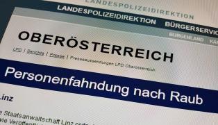 Polizei veröffentlichte Fahndungsfotos: Bei bewaffnetem Überfall in Linz-Industriegebiet-Hafen Auto geraubt
